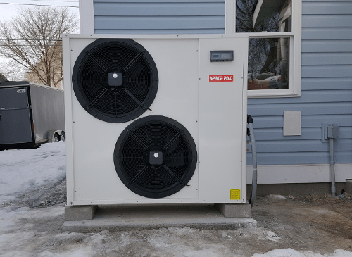 Solstice Heat pump outside an energy-efficient Habitat For Humanity home