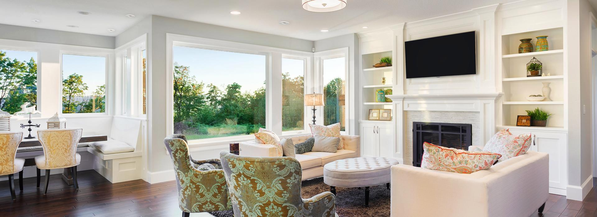 Living room with bright furniture and SpacePak outlets hidden in the ceiling