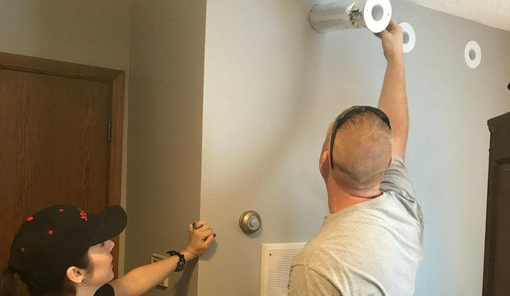 Anitra Mecadon and a certified SpacePak contractor installing wall outlets